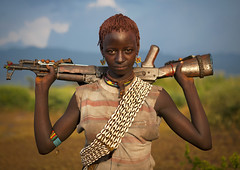 Bana girl with gun - Omo valley Ethiopia