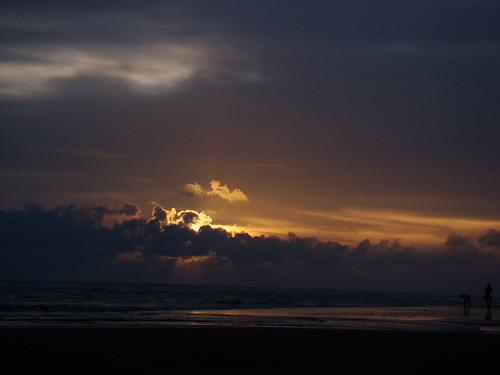 Sunset behind the cloud by enamur
