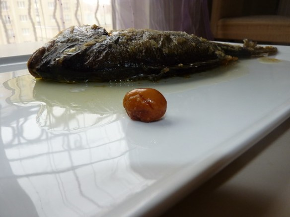 olive oiled and grilled Moronidae with green olive