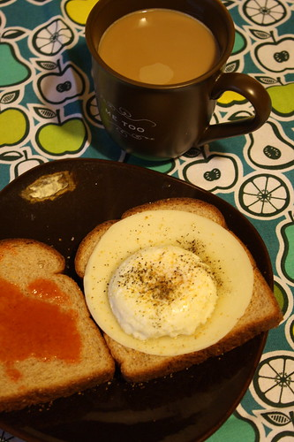 coffee, poached egg, toast, provolone cheese