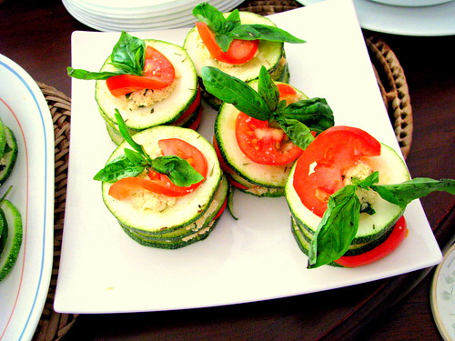 Fresh zucchini napoleon with soy ricotta and red pepper coulis