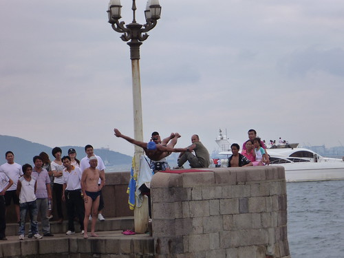 Old man showing off on Qingdao pier