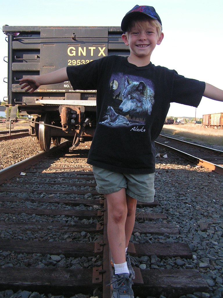 Max does a balance beam routine at the trainyard