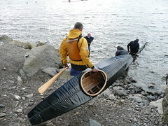 carrying the recovery kayak down to the lake