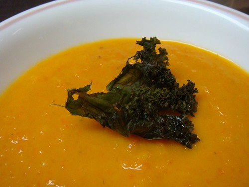 Carrot apple ginger coconut soup with a kale chip