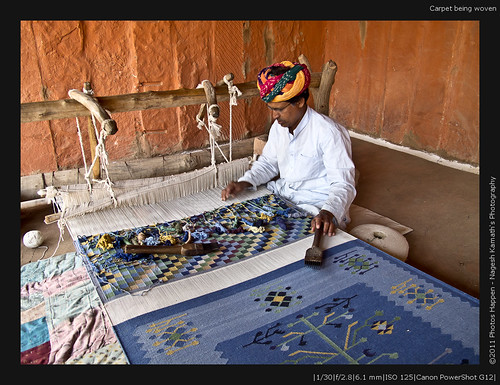 Carpet being woven