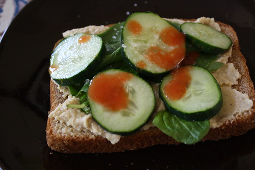 hummus, spinach, cucumber, hot sauce sandwich