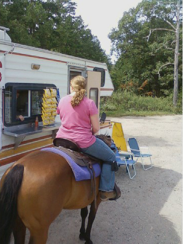 Rachel and Lily ordering hot dogs at the hot dog truck down the road from our barn