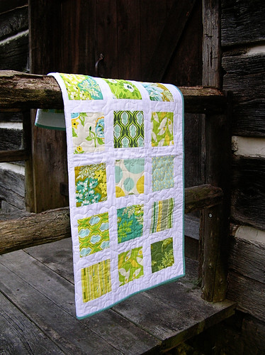 baby quilt on the porch