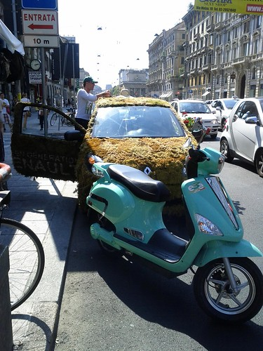Greenpeace grass car and Italian scooter, Milan, Italy