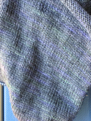 Close of up picture of an in-process knitted object, showing off individual stitches