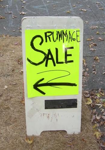 Scrawled rummage sale sign