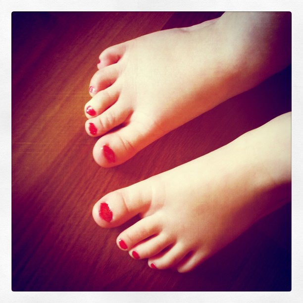 Bright #red #toenails today. With sparkles. I couldn't talk her out of it.