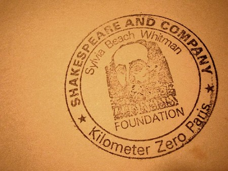 Shakespeare-and-Company-Kilometer-Zero-Paris-stamp-courtesy-Nicholas-Laughlin-at-Flickr-CC-450x337