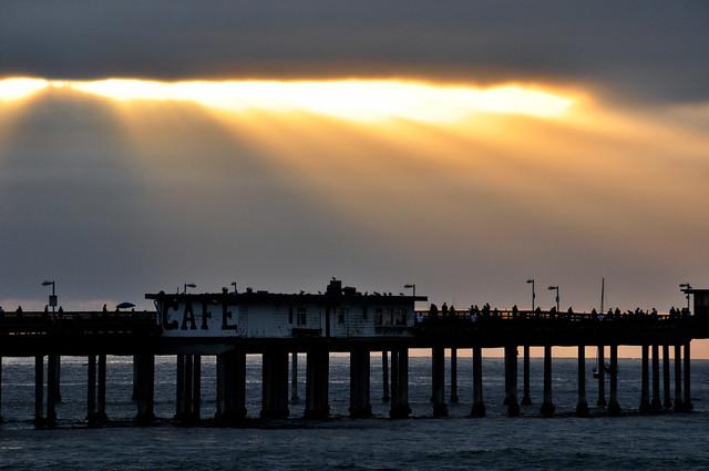 Sun Rays over Ocean Beach Pier.