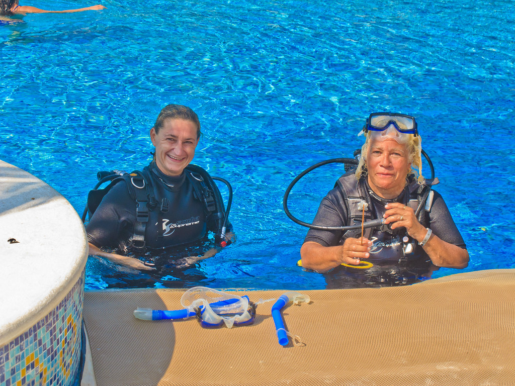 Chris and her diving instructor finishing a lesson at the pool