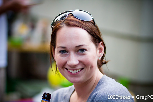 Face - woman with two nose studs and a pretty smile