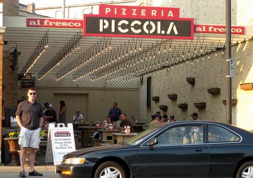 Chris outside of Pizzeria Piccola