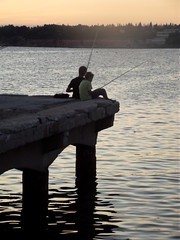 Children fishing at dusk
