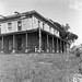 Front and side view with Mr. McKeachie standing in front, Aberglasslyn House, Aberglasslyn, NSW, Australia - March 24, 1961