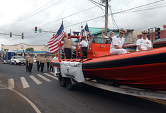 Sailors wave and march in Veterans Day Parade.