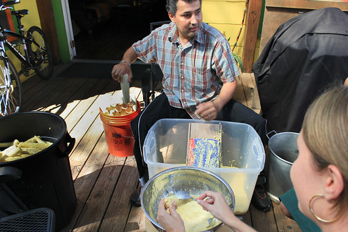 Toninho grating the fresh corn, with Sarah assisting (in foreground)