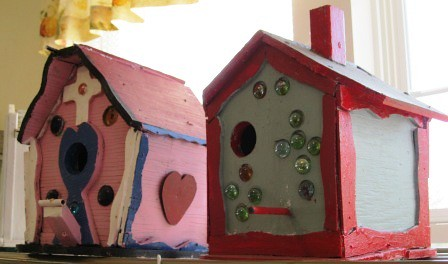 Whimsical upcycled birdhouses