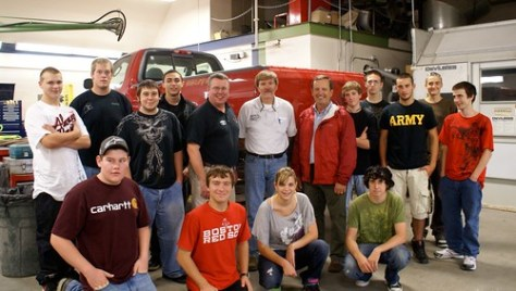Students from Region Ten Technical High School in Brunswick stand in front of the Ford F-150 pickup truck donated to the school by Hancock Lumber.