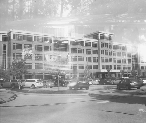 Anonymous office building double exposure