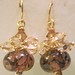 Boro burnt sugar petals in a brown background with hand wrapped Swarovski smoky topaz clusters.