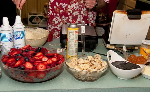 waffle irons and fresh toppings for the waffle bar at dawn and chris wedding photo susan helgeson