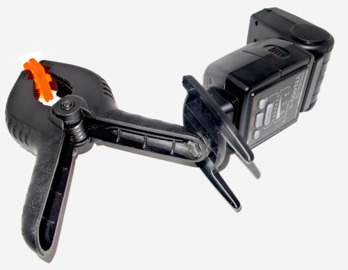 Off-camera flash mounted on a clamp.