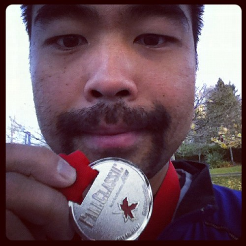 Holding the finisher's medal for the 2011 Fall Classic Half Marathon.