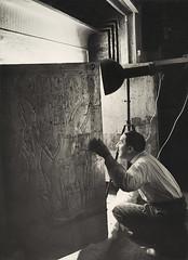 Howard Carter Looking through the Open Doors of Tutankhamun's Second Shrine of Tutankhamun, 1924, by Harry Burton