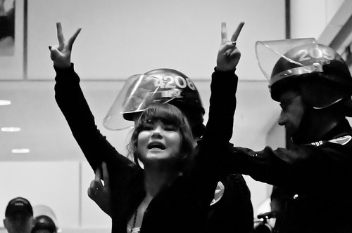 Photo of cops arresting @kendrayukiko during the occupation of a Bank of America branch in San Francisco on Nov, 16., 2012