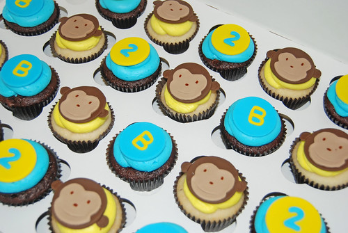 blue and yellow monkey themed 2nd birthday cupcake tower