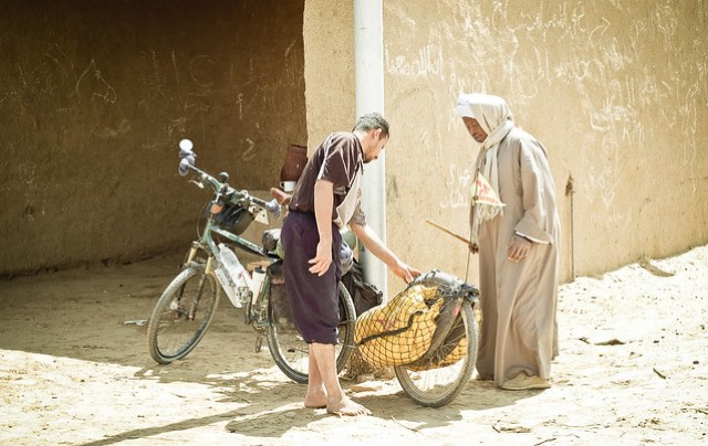 Egyptian locals inspecting my bike