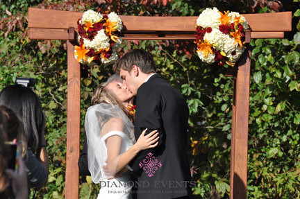 First kiss as husband and wife - ceremony at River Farm in Alexandria, Virginia