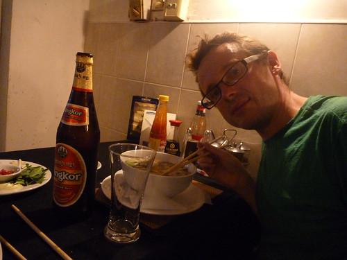 Col having pho and Angkor Beer