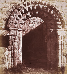 11th century Norman doorway of St Oran's Chapel, Iona, the chapel was named after Oran, a convert who is said to have been buried alive in order to consecrate the ground for the building, 1856, by Thomas Keith