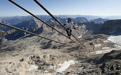 Freddy Nock balances on the cable car ropeway in the Alps on Germany's highest mountain, Zugspitze, near Garmisch-Partenkirchen, Germany, by Alexandra Beier