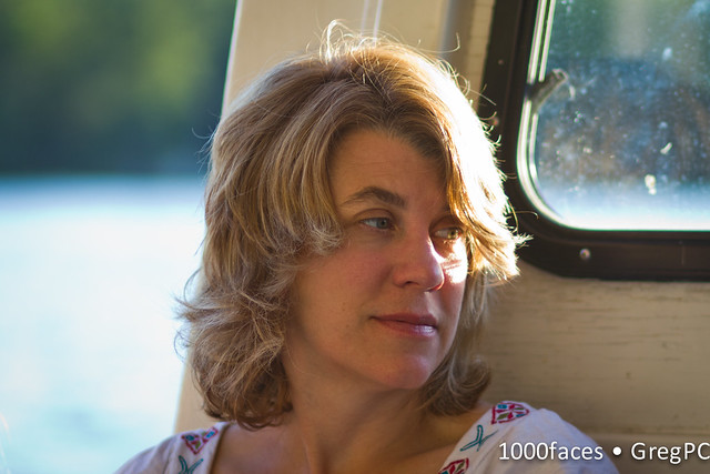 Face - a woman in the sun on a boat