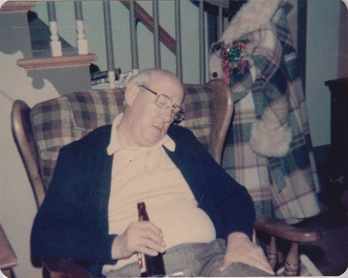 Grandpa Bell . Sleeping, with beer in hand.