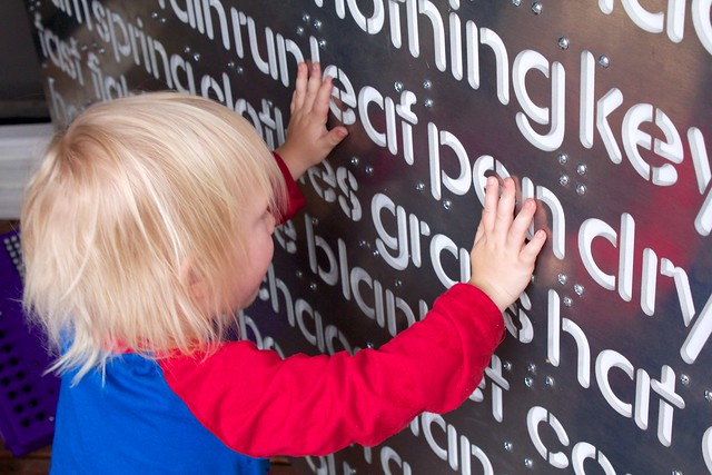 Auggie Playing With The Word Wall