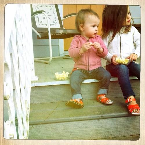 on the porch in orange sandals