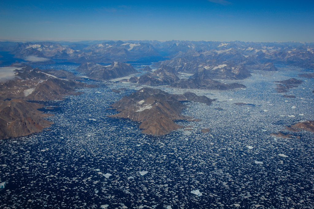 Flight aproach toward Kulusuk. Ice-strewn coast of East-Greenland.