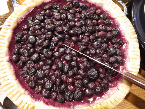 A photograph of a blueberry pie