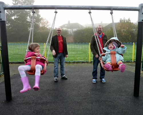 Millie and Izzy on the swings
