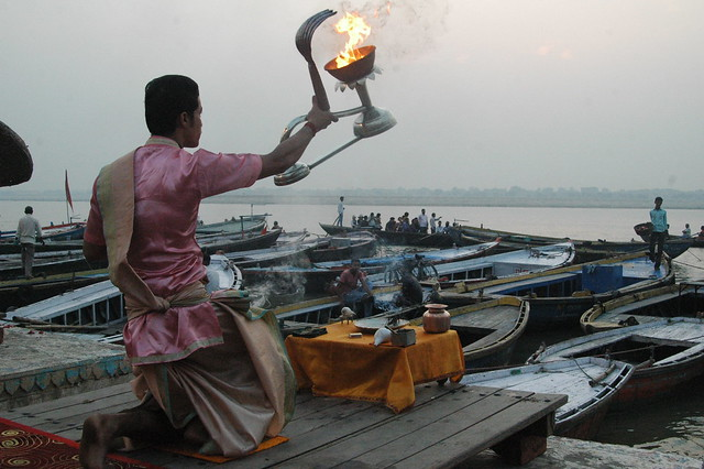 A priest performs aarti to The Ganges, every morning at the sunrise, Varanasi, india