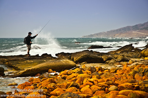 Straits of Gibraltar, Spain. Shore fishing on heavy seas conditions and strong wind by Nicola Zingarelli